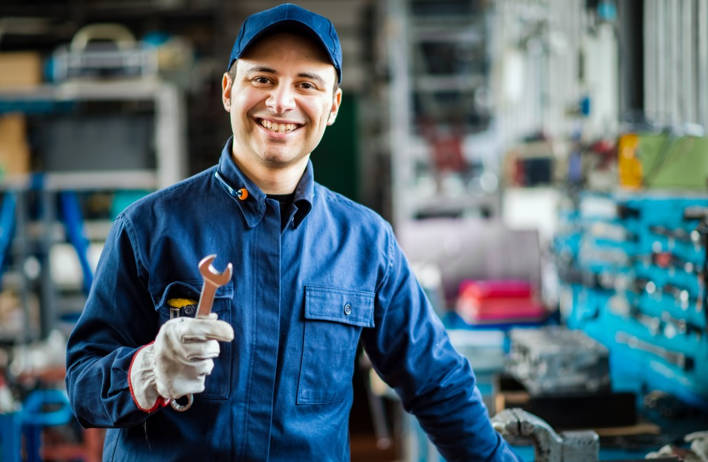Auto mechanic in car repair shop