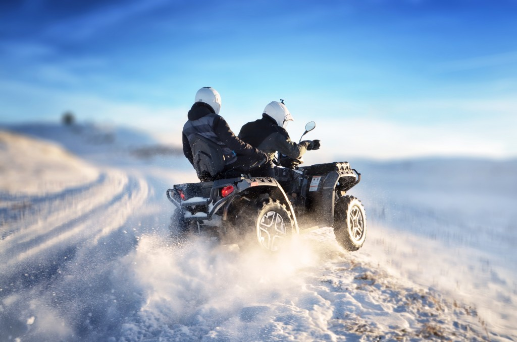 ATV riding on a mountain full of snow