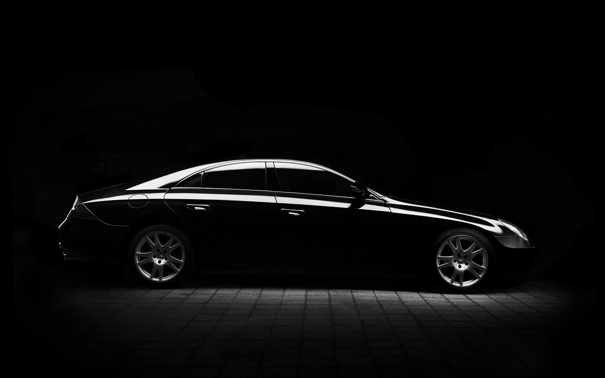 Luxury car in black background