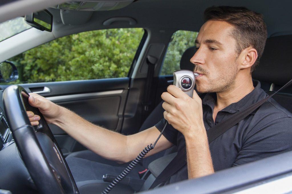 man using car Breathalyzer