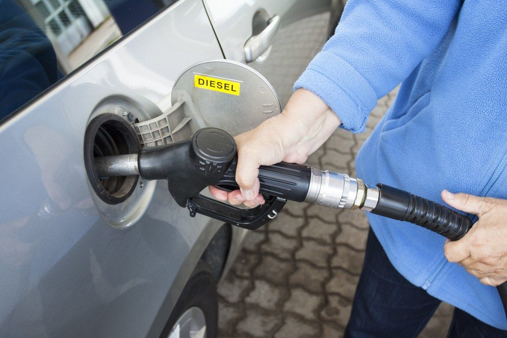 Filling up a car with diesel