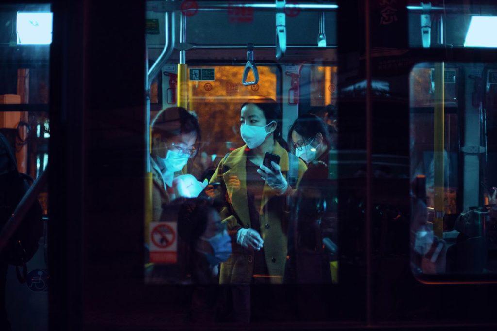 people wearing face masks inside public transportation